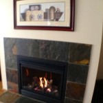 Tear out 80's Orleans wood fireplace, brick slice, Oak mantel  Replace with Napoleon GD36 gas fireplace, new drywall and dark slate.  Client thrilled two years later.