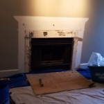Mantel taken down for wood fireplace removal.