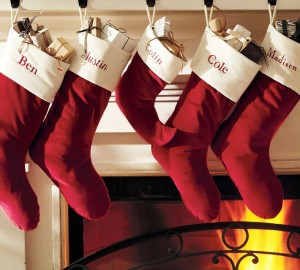 red-santa-claus-christmas-stocking-in-fireplace
